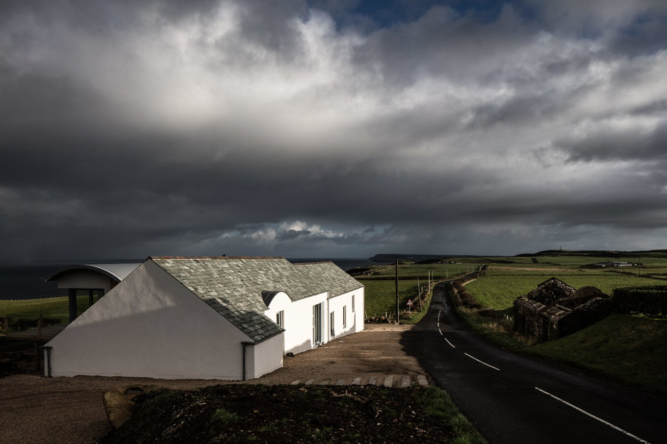 Built to hug the landscape and the sloping site the house includes seven different levels the curved element of the extension find its way inside